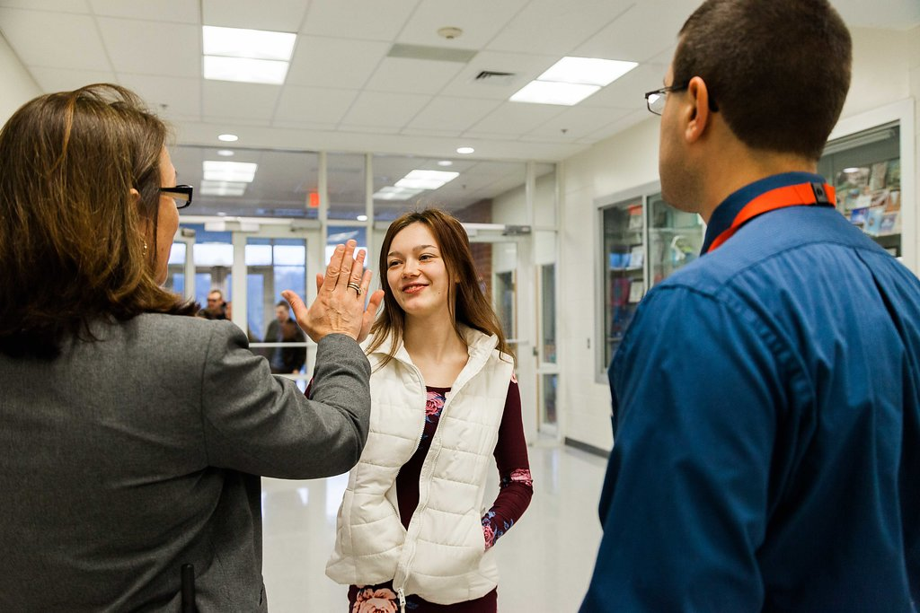 Megan Baker, principal at Tourtellotte High School in Thompson, Connecticut, greets one of her students.