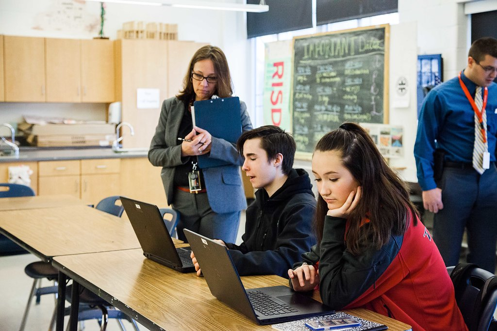 Megan Baker, principal at Tourtellotte High School in Thompson, Connecticut, Baker checks in with students in class as part of her weekly teacher observations. Baker is a graduate of the Neag School's principal training program. (Cat Boyce/UConn Photo)
