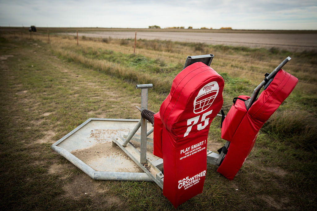 Football practice equipment sits on the practice field. (Photo by Andrew Burton/Getty Images)