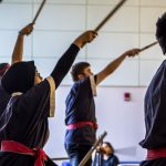 Yasmin Taib '21 (CLAS) (left foreground) performs with the UConn Taiko Club. (Lucas Voghell '20 (CLAS)/UConn Photo)