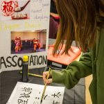 Yuqi Li '21 (CLAS) from the Chinese Calligraphy Club shows an example of her art. (Lucas Voghell '20 (CLAS)/UConn Photo)