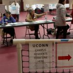 UConn students and town residents are given separate registration tables. (Lucas Voghell '20 (CLAS)/UConn Photo)