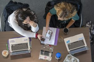 Overhead view of students studying at the School of Pharmacy. (Sean Flynn/UConn Photo)