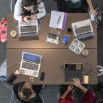 An overhead view of students studying at the School of Pharmacy. (Sean Flynn/UConn Photo)