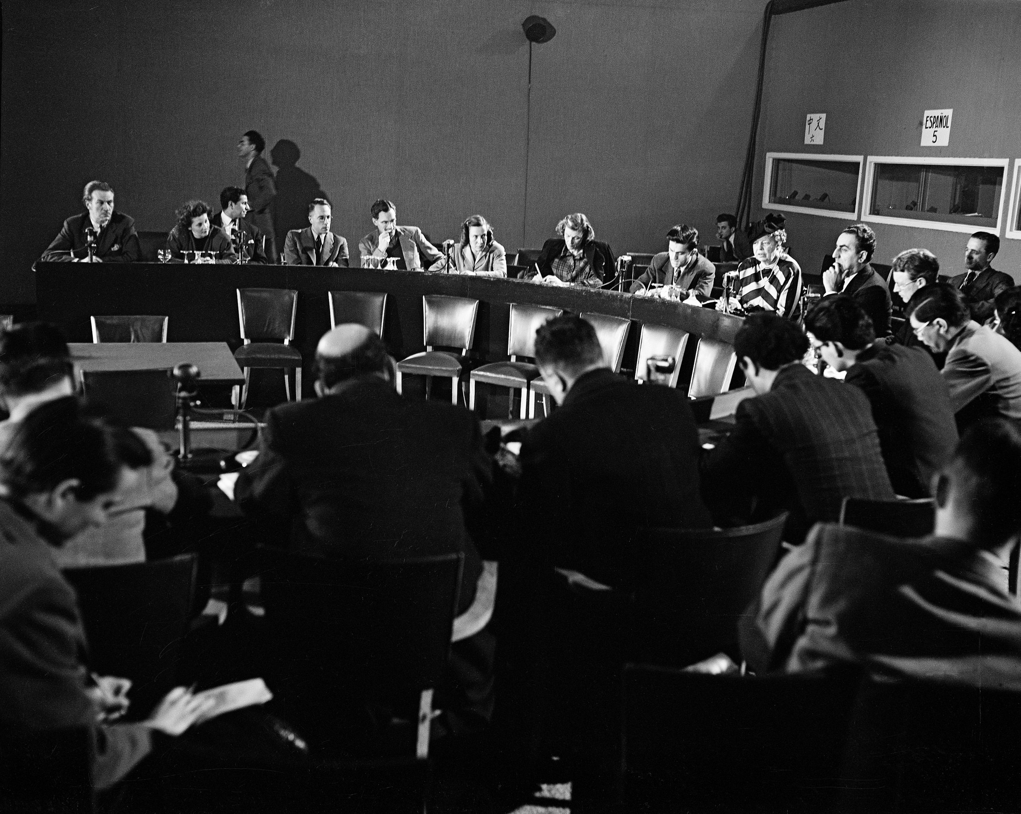 Eleanor Roosevelt, chairman of the Human Rights Commission, and Charles Malik, chairman of the General Assembly's Third Committee (second from right), speak at a press conference after the completion of the Declaration of Human Rights in 1948. The Declaration turns 70 this month. (United Nations Photo)