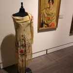 A scarf displayed near a Rand portrait of Anna Delancy Mears wearing a floral shawl. Courtesy of the New Britain Museum of Art.