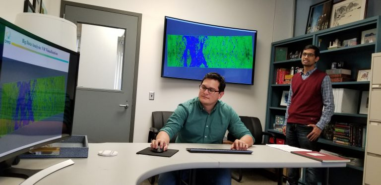 Materials science and engineering graduate student Marco Echeverria (seated) and Rajesh Kumar, postdoctoral researcher in materials science and engineering and the Institute of Materials Science. (UConn Photo)