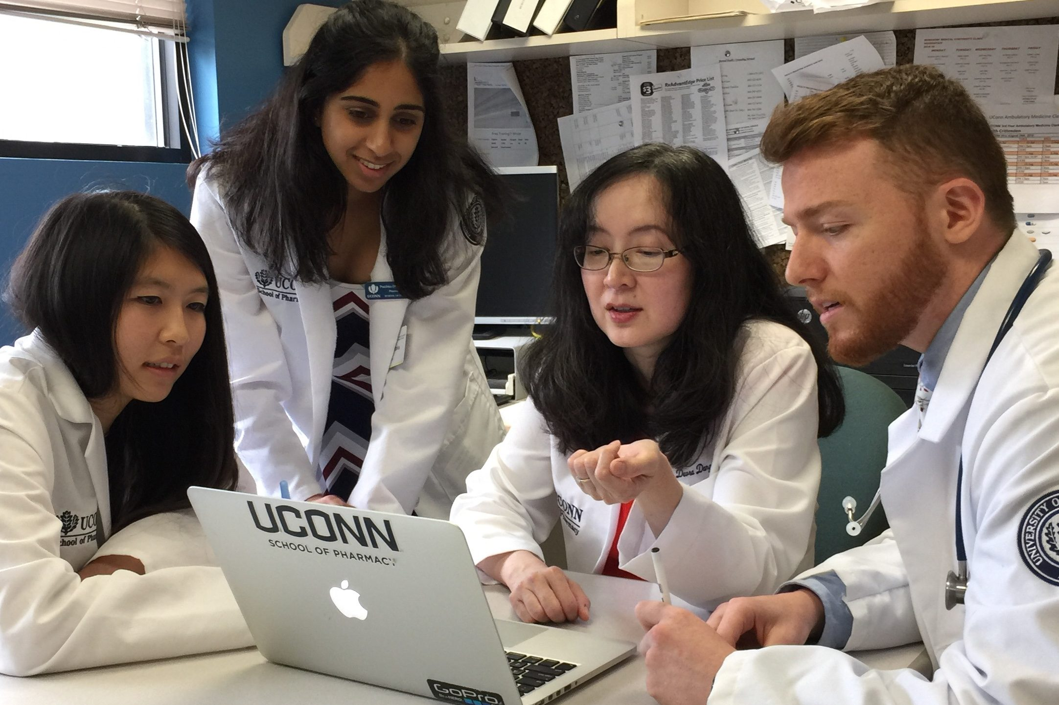 Devra Dang meets with students to discuss a patient's diagnosis.
