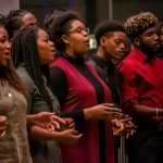 Members of the Voices of Freedom gospel choir perform under the direction of the Rev. Lisa Clayton during the Kwanzaa celebrations hosted by the African American Cultural Center on Dec. 7. (Lucas Voghell '20 (CLAS)/UConn Photo)
