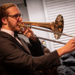 Trombonist Nick Stanton '21 (SFA) practices before taking the stage.  (Lucas Voghell '20 (CLAS) / UConn Photo)