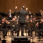 """Paul McSchee, Director of Orchestral Studies, conducts the orchestra in a performance of Scott Joplin's """"Overture to Treemonisha"""".  (Lucas Voghell '20 (CLAS) / UConn Photo)"""