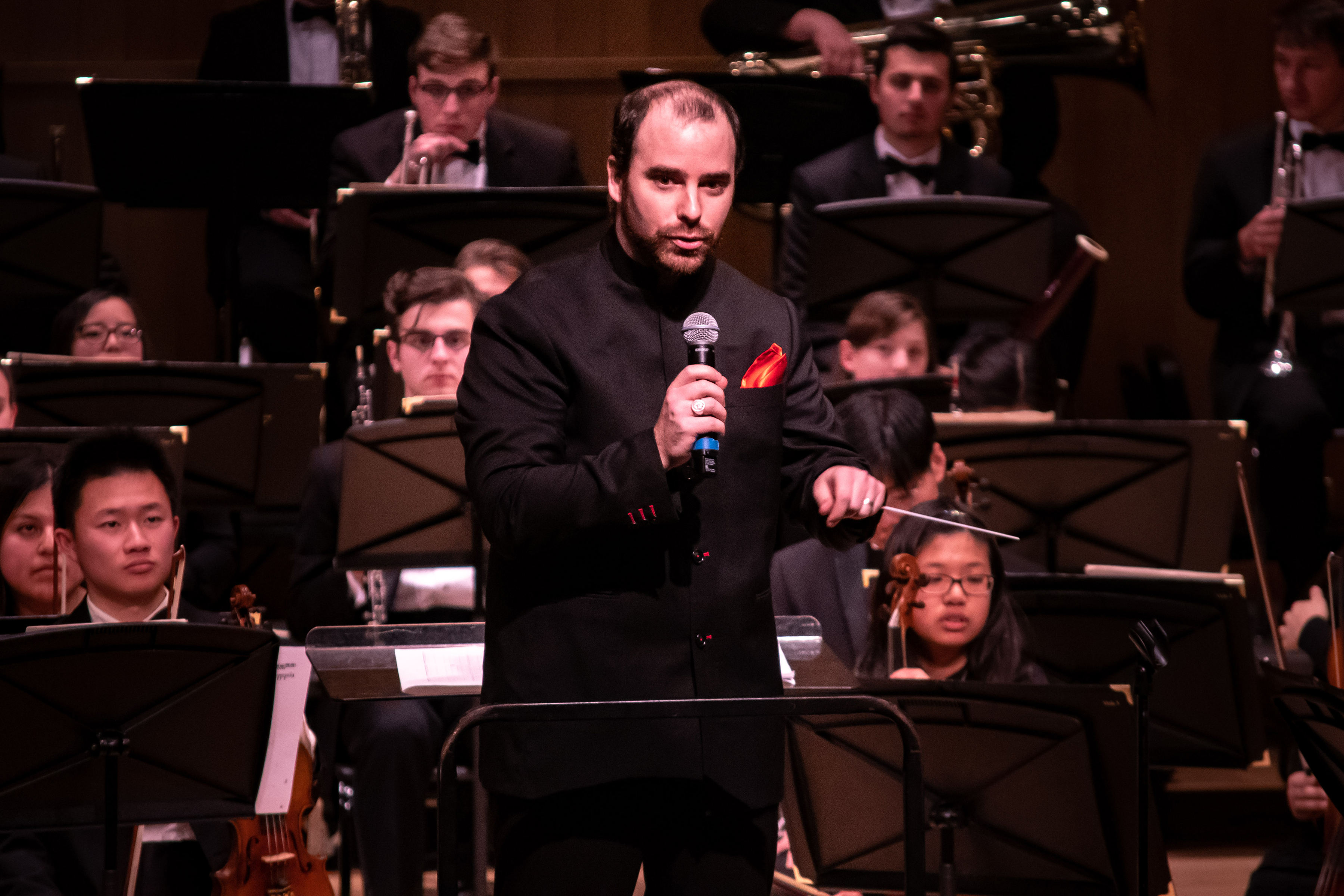 "Conductor Paul McShee recounts a history of Margaret Bonds, a composer and activist who wrote during the 1950s and '60s, and whose composition ""Montgomery Variations"" was debuted on Dec. 6. (Lucas Voghell '20 (CLAS)/UConn Photo)"