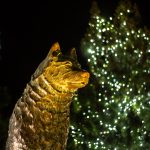 The Husky Dog statue against a backdrop of holiday lights near Gampel Pavilion. (Lucas Voghell '20 (CLAS)/UConn Photo)