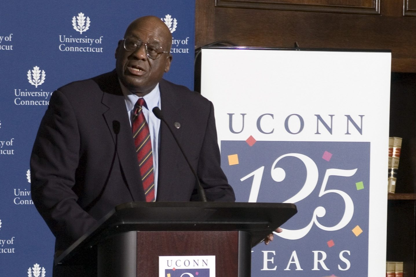 Alfred Rogers '53 (CLAS), '63 JD, speaks on campus as part of the 125th Anniversary celebrations in 2006. (UConn File Photo)