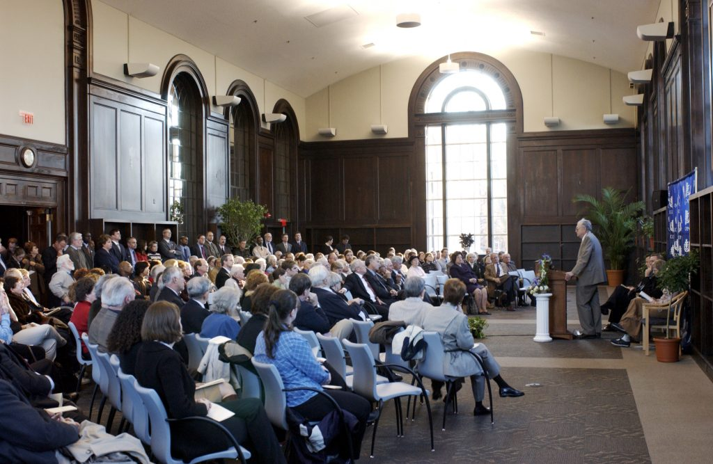 Norman Stevens, former director of university libraries, speaks at the rededication ceremony of the Wilbur Cross Building in 2003.