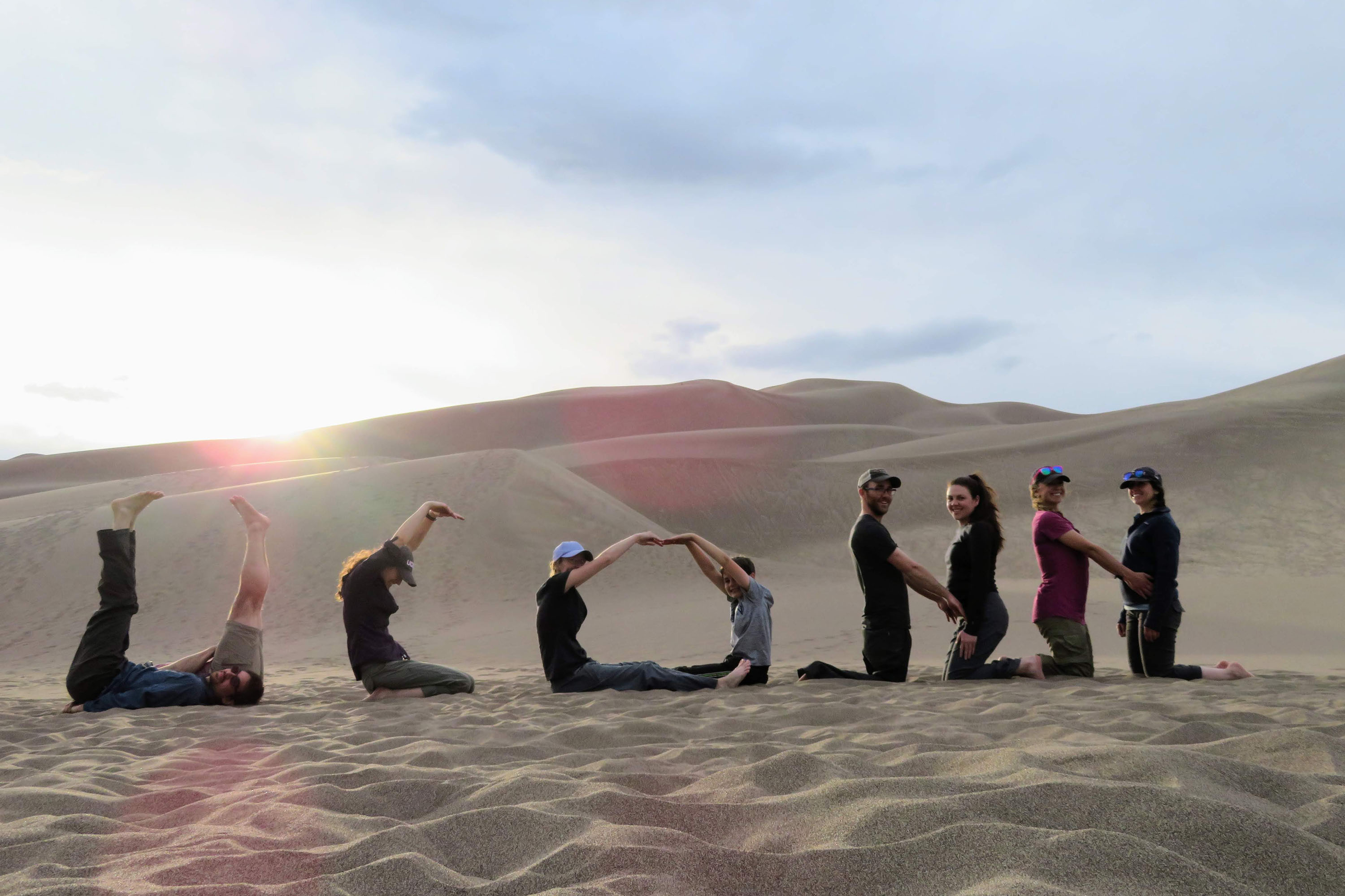 Students on dune: Geosciences students spell 'UConn' in May 2018 at Great Sand Dunes National Park and Preserve, Colorado. The trip was part of a field course, 'Field Geology & Landscapes of the Western U.S.,' which included a two-week field trip to Colorado, Utah, and Arizona. (Will Ouimet/UConn Photo)