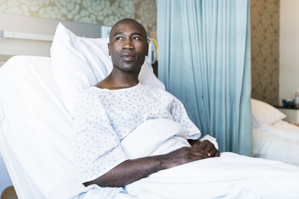 An African American man in a hospital bed. The HDI Report Card notes that men of color in Connecticut are far more likely to die of cancers or of heart, cardiovascular, and lung diseases than non-Hispanic white men, among other disparities in health care access and health outcomes. (Getty Images)