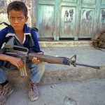 This 12-year-old guerrilla fighter said he joined the rebels after witnessing soldiers kill his parents, Usulután Department, El Salvador, 1989. (Photo by Scott Wallace)