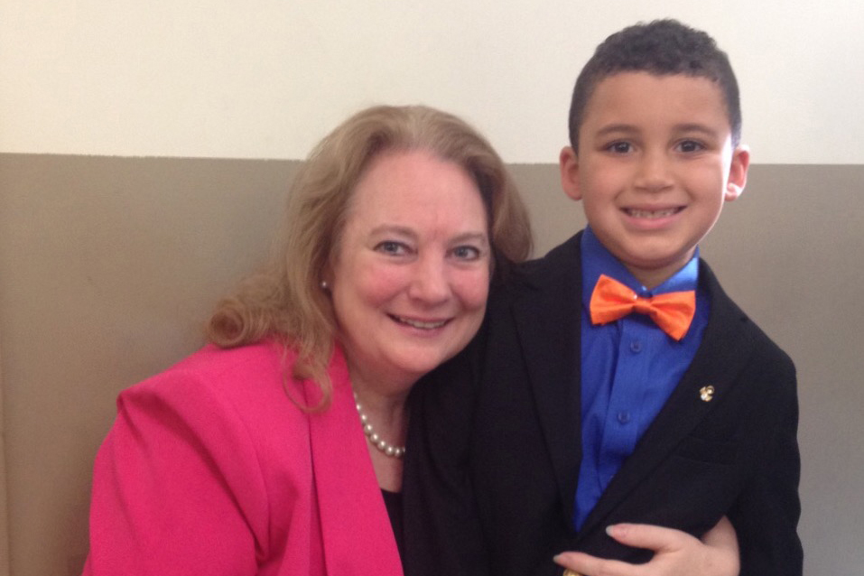Court-appointed special advocate Susan Brillhart with one of her charges, Anthony, on the day he was adopted. His new family stays in touch. (Photo courtesy of Susan Brillhart)