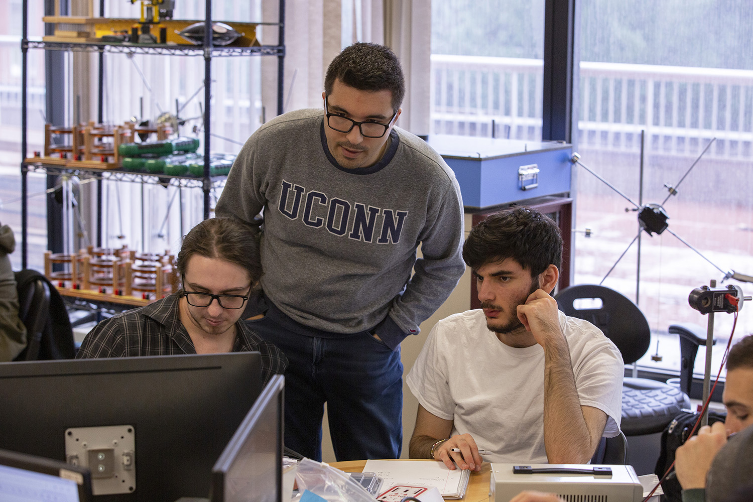 Graduate teaching assistant Lukasz Kuna instructs PHYS 1602: Fundamentals of Physics II in a new Studio Learning Lab located in the Gant Science Complex on November 5, 2018. (Bri Diaz/UConn Photo)
