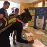Sasha Richardson, a graduate student, signs the UConn PIRG petition at the Student Union to ban plastic bags in Dining Services locations on campus. Also shown are Alex Pawlka, left, and Tori Zane. (Photo courtesy of UConn PIRG)