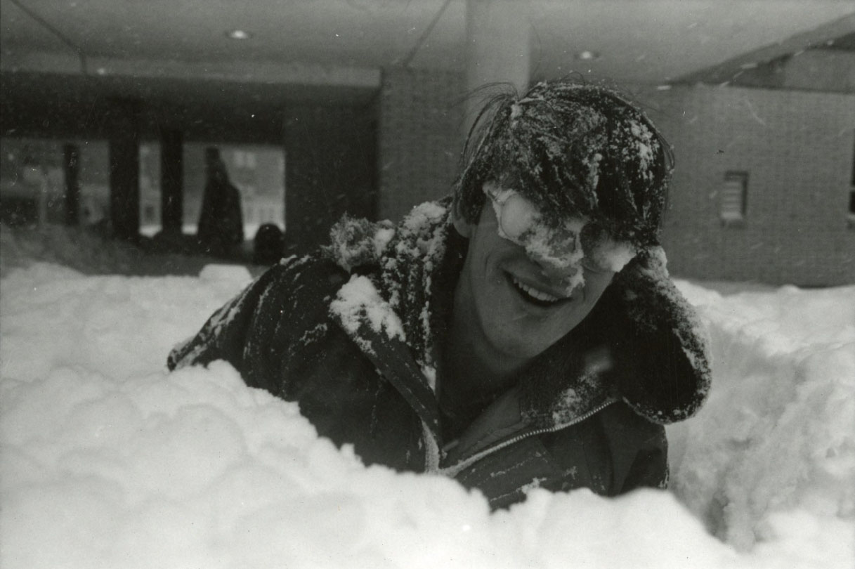 A student enjoys the snow on campus during the blizzard of 1978. (Photo from University Library Archives & Special Collections)