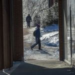 Students make their way to class outside the School of Nursing's Widmer Wing. (Sean Flynn/UConn Photo)