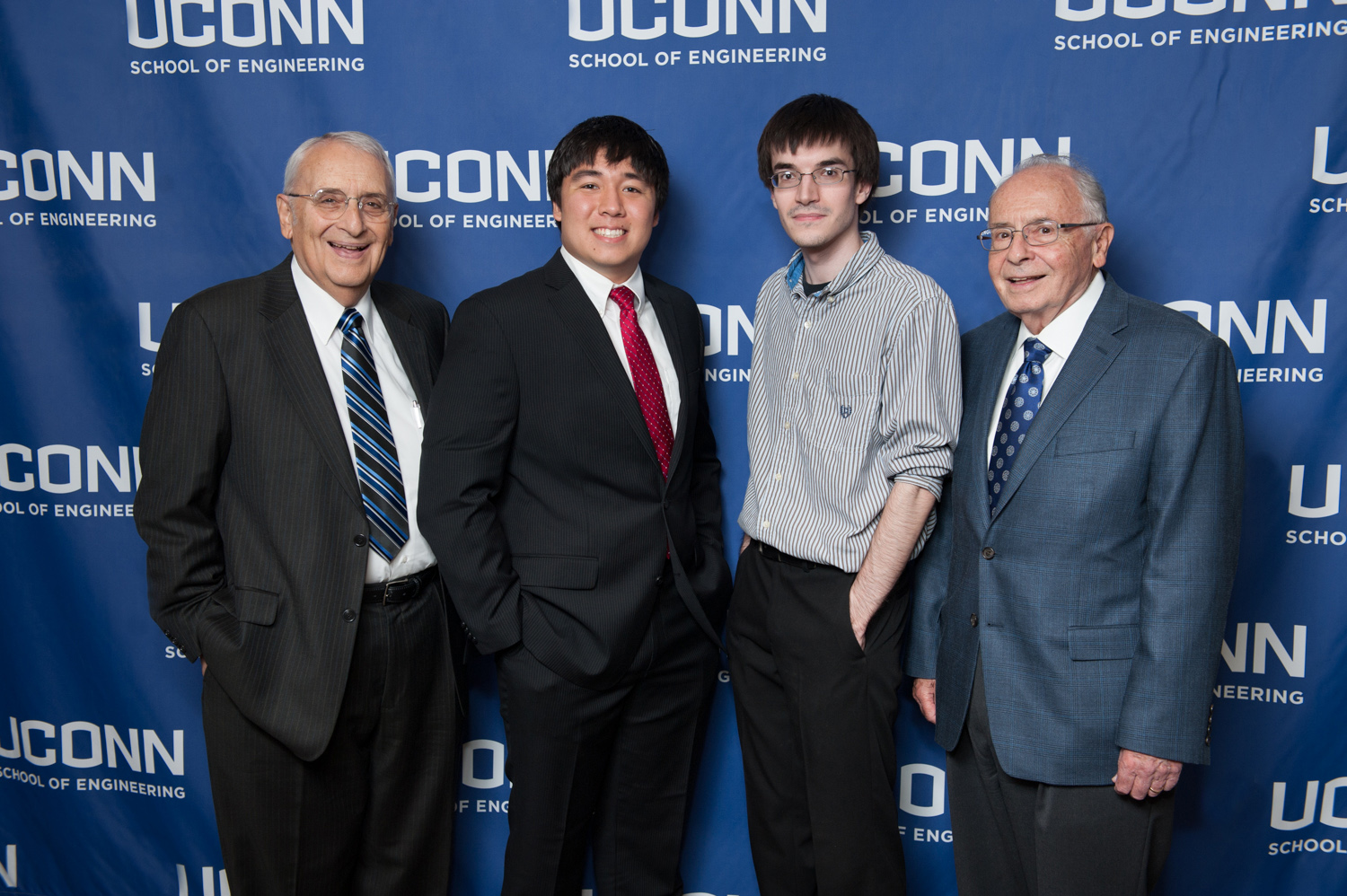 Stephen Altschuler (far left) and Sam Altschuler (far right) stand with their undergraduate scholarship recipients at a ceremony in 2015. (Christopher Larosa/UConn Photo)