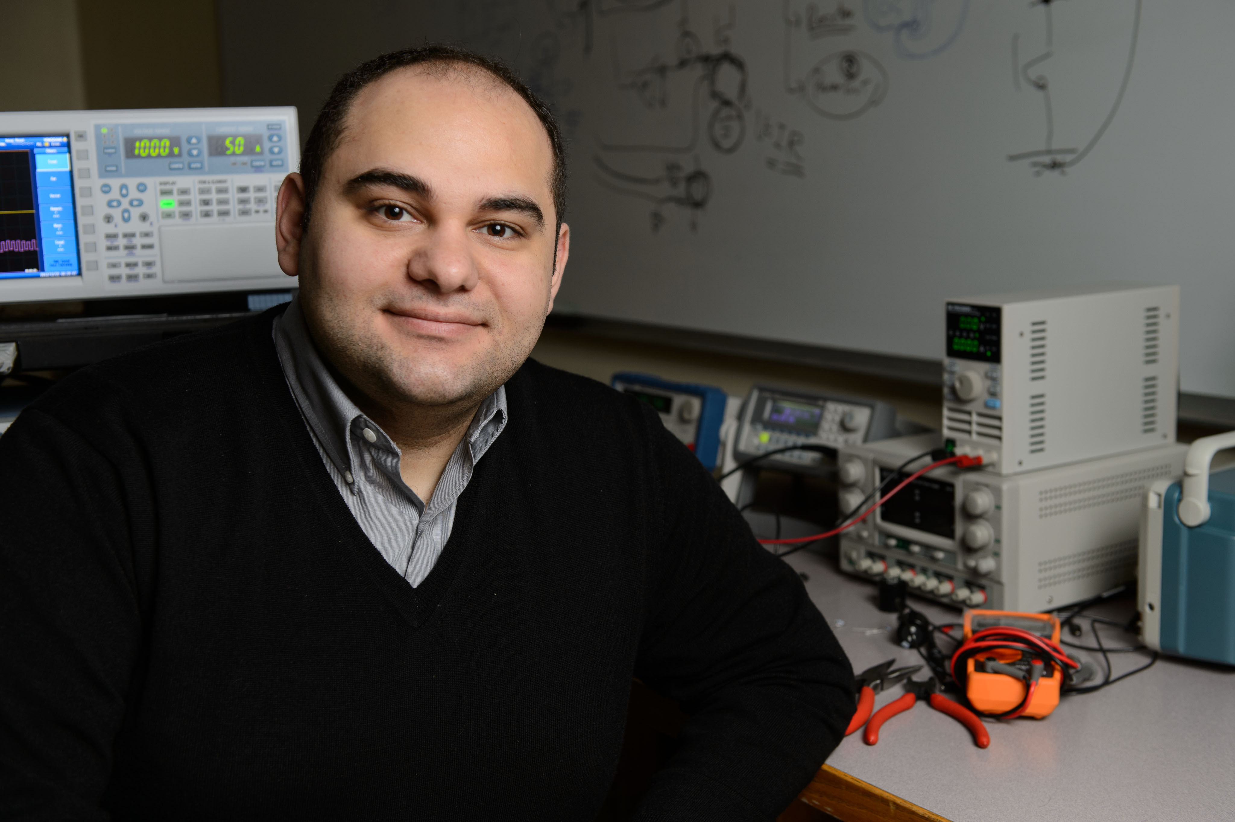 Ali Bazzi, assistant professor of electrical and computer engineering at his lab on Dec. 21, 2012. (Peter Morenus/UConn Photo)