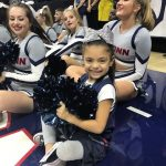 Daniela having fun with the cheerleading squad.