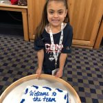 Daniela poses with her welcome cake at a party hosted by the Women's Basketball team after her signing ceremony on Nov. 11, 2018.