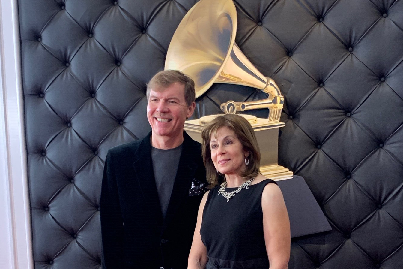 Composer Kenneth Fuchs, professor of music, left, and conductor JoAnn Falletta, after winning a Grammy on Sunday, in the Best Classical Compendium category for the album 'Spiritualist – Concerto for Piano and Orchestra.' (Photo courtesy of Kenneth Fuchs)
