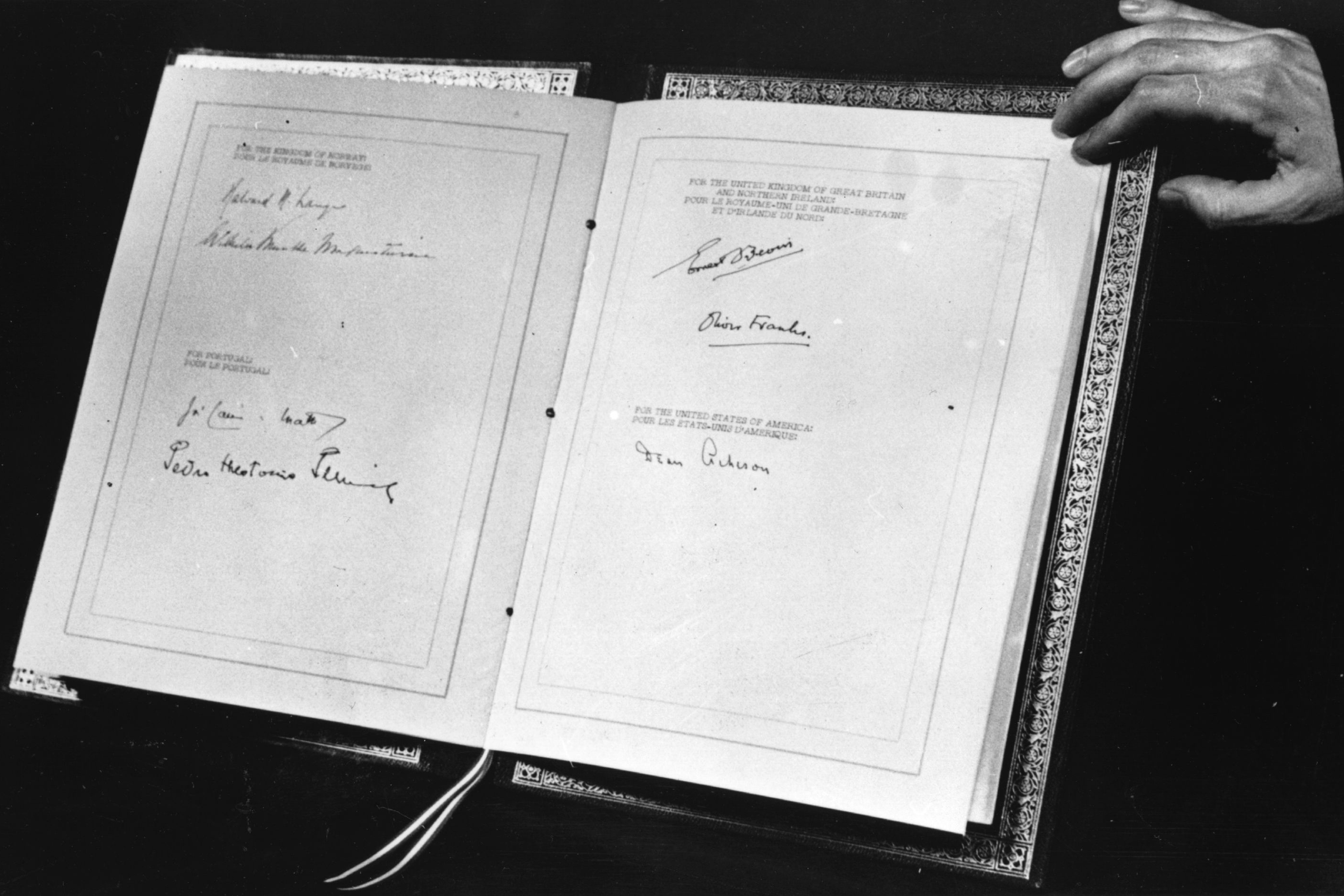 The April 4, 1949 document that established the North Atlantic Treaty Organization, showing the signatures of foreign secretaries and ambassadors of the original signing nations – Belgium, Britain, Canada, Denmark, France, Iceland, Italy, Luxembourg, the Netherlands, Norway, Portugal, and the United States. NATO was established for the purposes of collective security. Because the document was signed in the U.S., the signature of Secretary of State Dean Acheson is the last to appear. (Photo by Keystone/Getty Images)