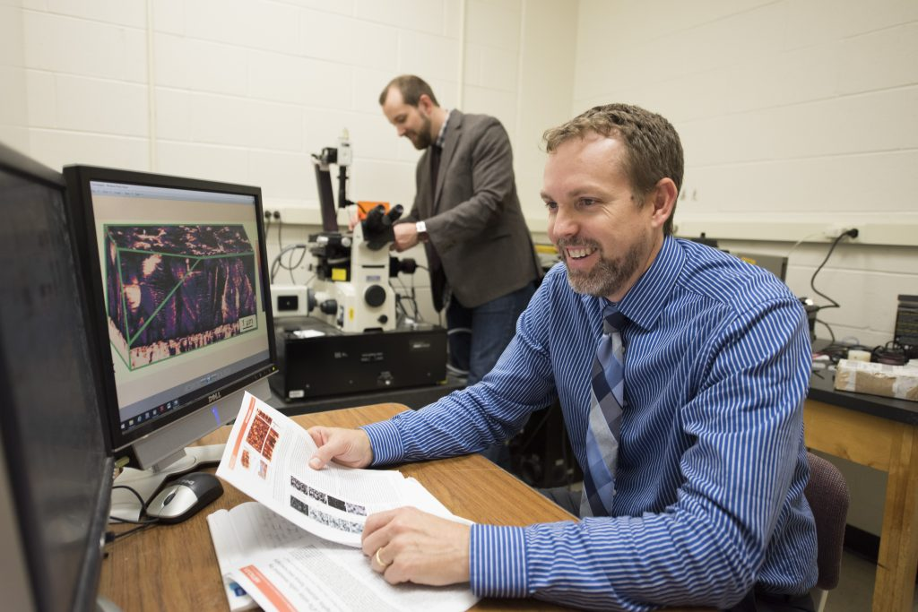 Bryan Huey, head of the Department of Materials Science & Engineering, foreground, and a colleague in the lab. (Ryan Glista/UConn File Photo)