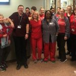 UConn dermatology staff wearing red