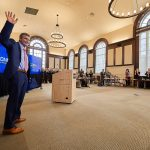 Thomas Katsouleas waves as he enters the Wilbur Cross North Reading Room, following his appointment to be the 16th University president on Feb. 5, 2019. (Peter Morenus/UConn Photo)