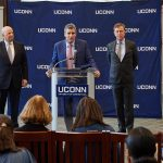 Thomas Katsouleas, center, speaks at a press conference at the Wilbur Cross North Reading Room, following his appointment to be the 16th president of the University on Feb. 5, 2019. At left is board chair Thomas Kruger. At right is Gov. Ned Lamont. (Peter Morenus/UConn Photo)