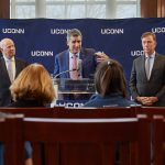 Thomas Katsouleas, center, speaks at a press conference following his appointment to be the 16th president of the University on Feb. 5, 2019. At left is board chair Thomas Kruger. At right is Gov. Ned Lamont. (Peter Morenus/UConn Photo)