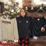 Maddox unwraps gifts of UConn gear from his team on Christmas Day. (Photo by Sherry Bruening)