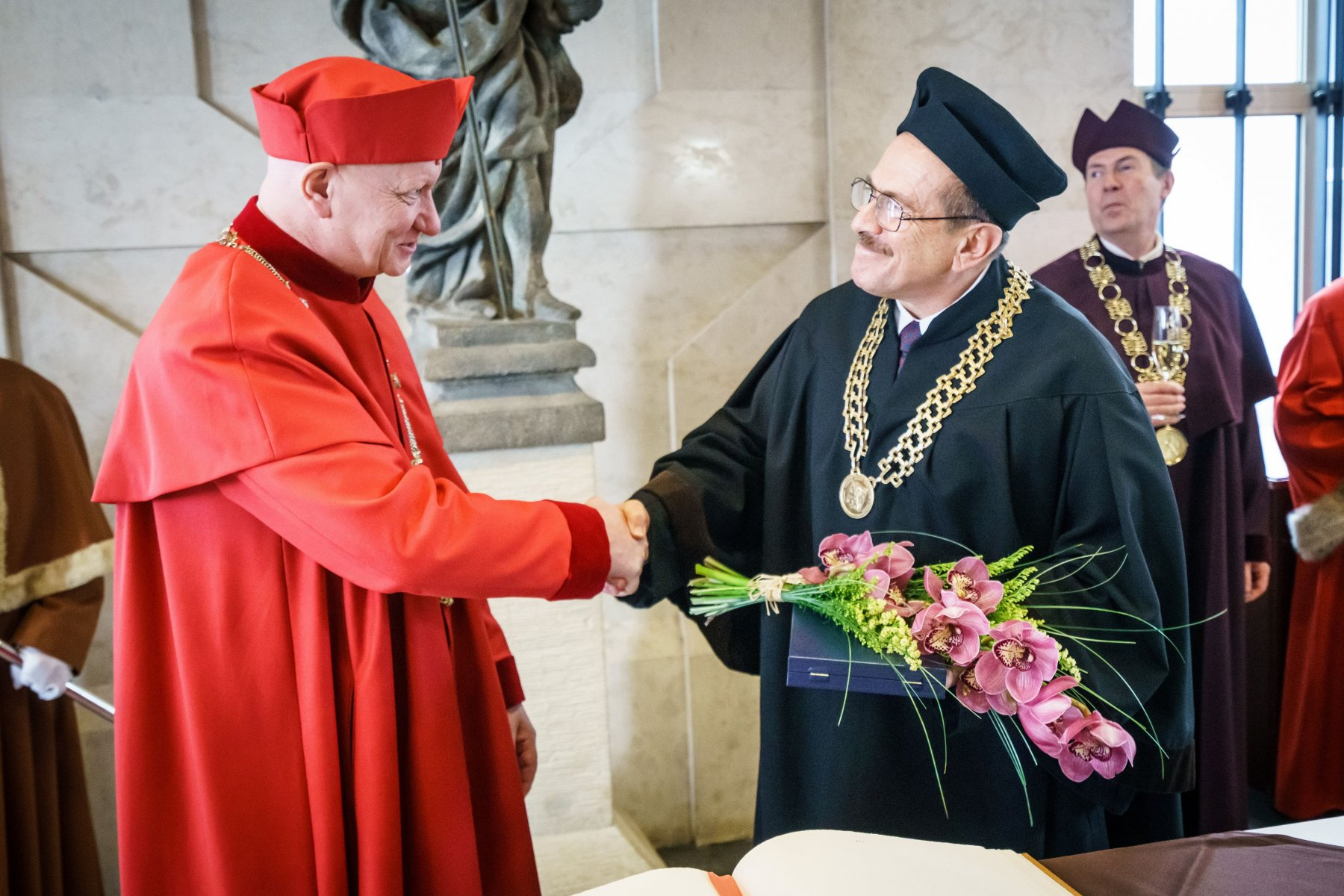 Olgac, right, receives his doctorate in a ceremony that took place on January 29. (Photo Courtesy of Czech Technical University )