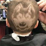 Rylan has his head shaved with the Husky dog logo. His mom says Coach Hurley has taken a particular interest in his hair-dos. (Photo by Tanya Ellingwood)