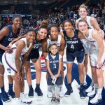 Daniela with members of the Women's Basketball team at First Night on Oct. 12, 2018. She says 'all' the players are her favorites. (Stephen Slade '89 (SFA) for UConn)