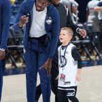 Mamadou Diarra speaks with Rylan on the court at the XL Center. (Stephen Slade '89 (SFA) for UConn)
