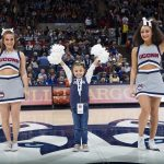 Daniela with cheerleaders at Gampel Pavilion, the night of the team's season opener against Ohio State on Nov. 11, 2018. (Stephen Slade '89 (SFA) for UConn)
