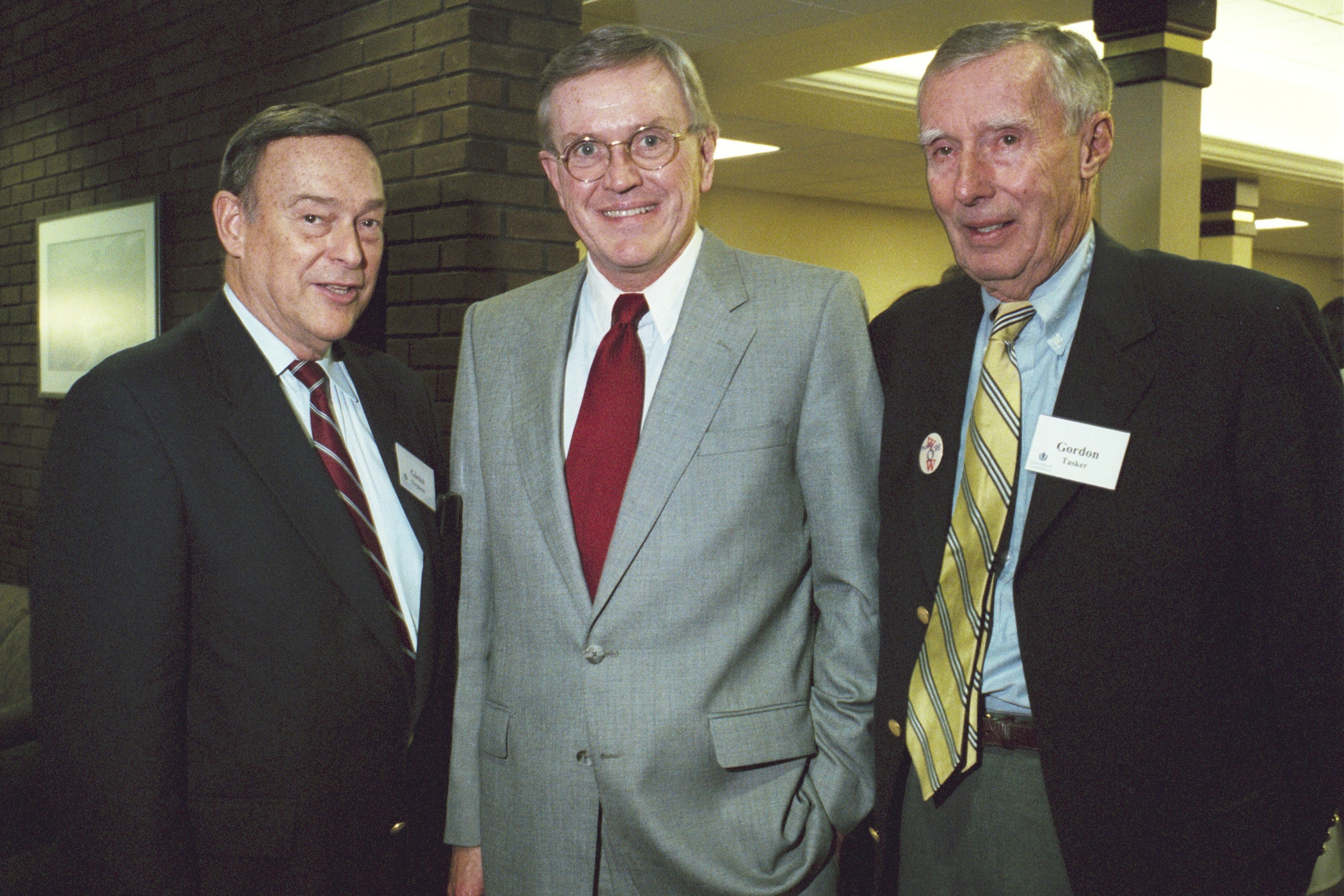 Gordon Tasker, former chairman of the Board of Trustees, right, with former university presidents Philip Austin, center, and Glenn W. Ferguson, at the dedication of the Tasker Building in 1998. (Peter Morenus/UConn File Photo)