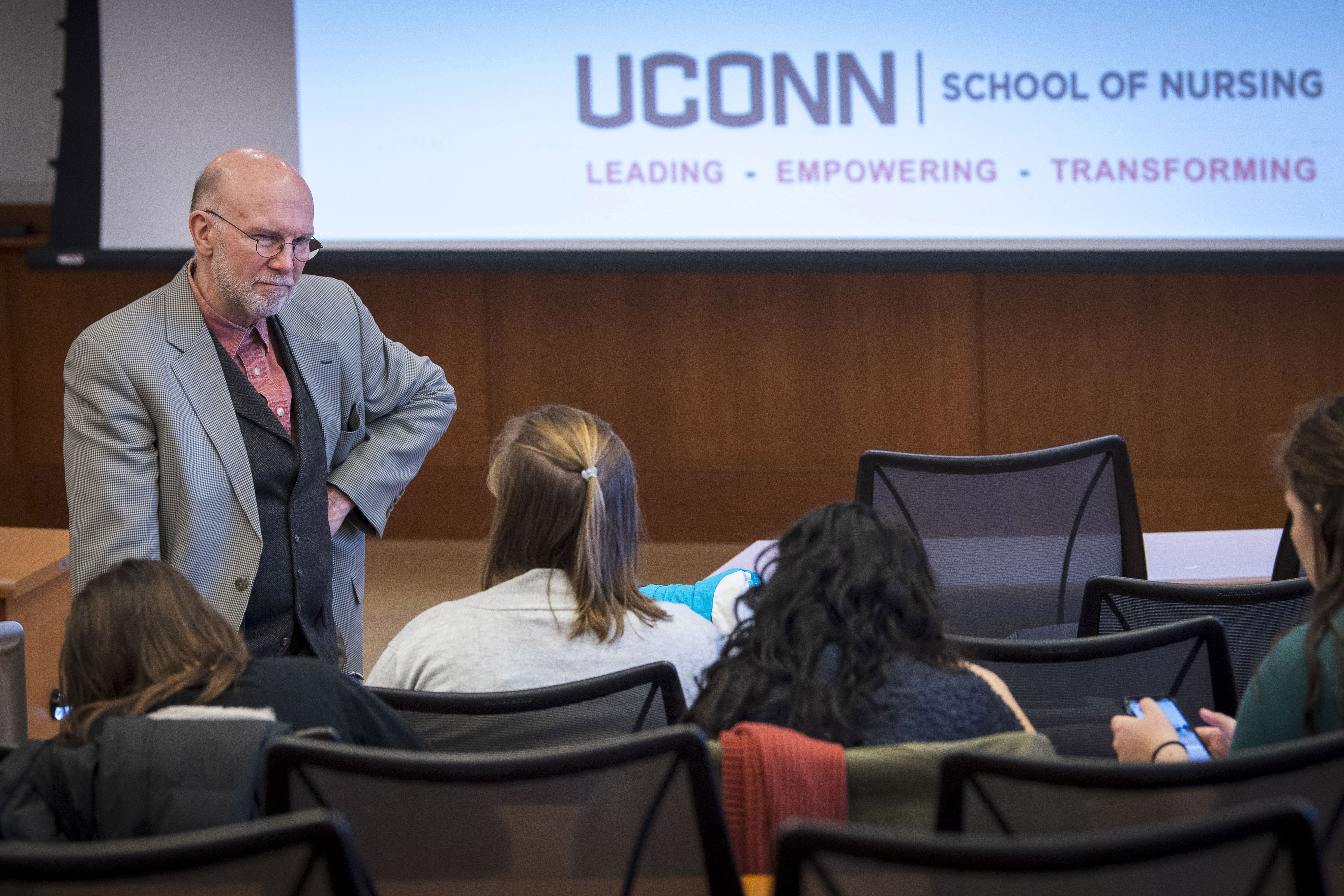 Professor Tom Long gives a lecture in the Widmer Wing of the School of Nursing. (Sean Flynn/UConn Photo)