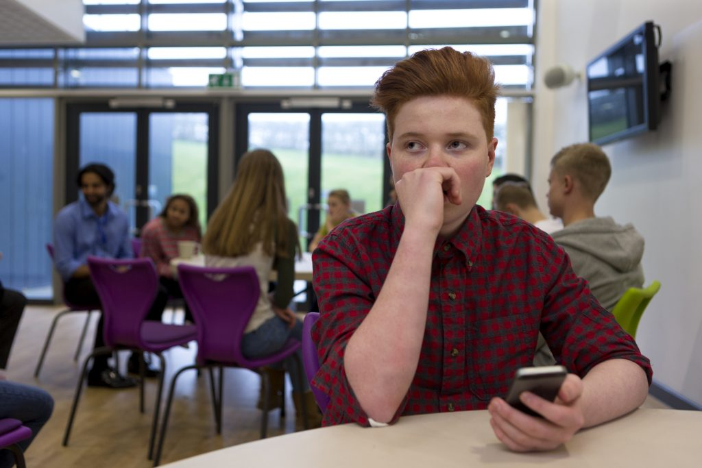 As many as 44 percent of LGBTQ teens report weight-based bullying from both peers and family members, says a new UConn study. (Shutterstock Photo)