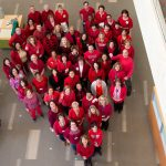 Staff at UConn Health donned their red gear and formed a large heart in the main lobby, dedicated to raising awareness about cardiovascular disease, and kicking off American Heart Month on Feb. 1, 2019. (Tina Encarnacion/UConn Health Photo)
