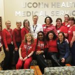 Staff at the Storrs office of UConn Health donned their red gear, to raise awareness about cardiovascular disease, and kicking off American Heart Month on Feb. 1, 2019. (Tina Encarnacion/UConn Health Photo)