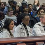 Fourth-year medical student Roshni Patel, left, testifies, as fourth-year dental student Chidera Amilo and clinical faculty member Christopher Steele listen, during testimony to the Appropriations Committee of the Connecticut General Assembly on March 7. (Ariel Dowski for UConn)